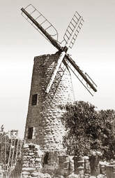 A white and black photograph of the Jerusalem windmill after the War of Independence in which the British army destroyed the windmill's cap